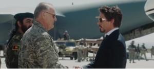 Au début d'Ironman, Tony Stark (à droite) vient présenter au potentiel acheteur, l'armée américaine, sa nouvelle invention d'armement high-tech, le missile Jéricho que nous pouvons apercevoir au centre de l'image à l'arrière-plan. En le mettant en rapport avec l'avant-plan qui montre la poignée de main entre l'armée et le fabricant d'armes, cette image cumule ainsi les trois casquettes de Stark : l'inventeur, l'industriel et le marchand.